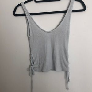 Light blue tank top with ties on the sides